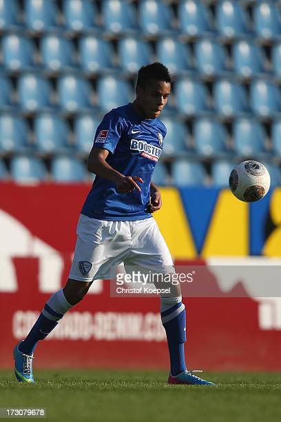 Jan Gyamerah of Bochum runs with the ball during the friendly match between VfL Bochum and Bayer 04 Leverkusen at Rewirpower Stadion on July 6 2013...