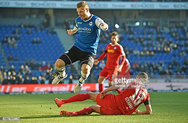Jan Gyamerah of Bochum tackles Florian Hartherz of Bielefeld during the Second Bundesliga match between DSC Arminia Bielefeld and VfL Bochum 1848 at...