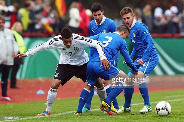 Jan Gyamerah of Germany is challenged by Filippo Costa of Italy during the U18 international friendly match between Germany and Italy at Sportpark on...
