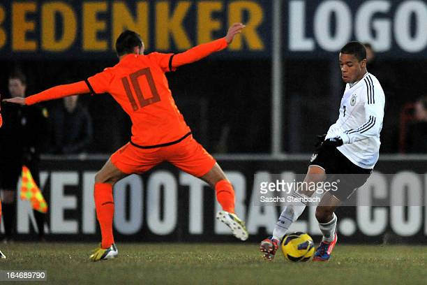 Jan Gyamerah of Germany vies with Rai Vloet of The Netherlands during the U18 International Friendly match between The Netherlands and Germany on...