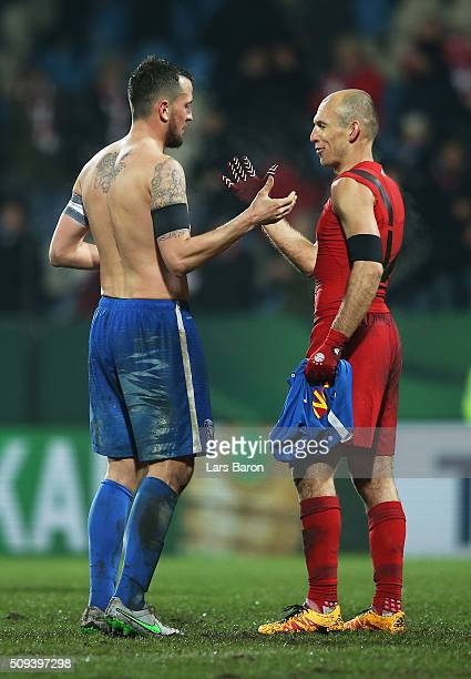 Jan Gyamerah of VfL Bochum shakes hands with Arjen Robben of Bayern Muenchen following the final whistle during the DFB Cup quarter final match...