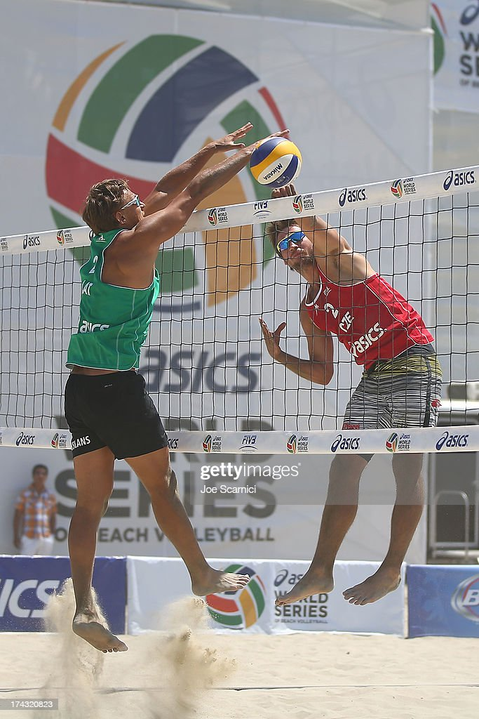Jan Hadrava of Czech Republic blocks a spike by Ruslans Sorokins of Latvia at the ASICS World Series of Beach Volleyball - Day 2 on July 23, 2013 in Long Beach, California.
