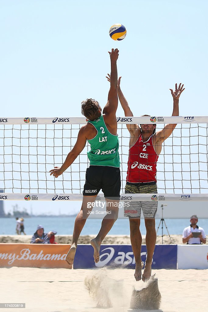 Jan Hadrava (R) of Czech Republic tries to block a spike by Ruslans Sorokins of Latvia at the ASICS World Series of Beach Volleyball - Day 2 on July 23, 2013 in Long Beach, California.