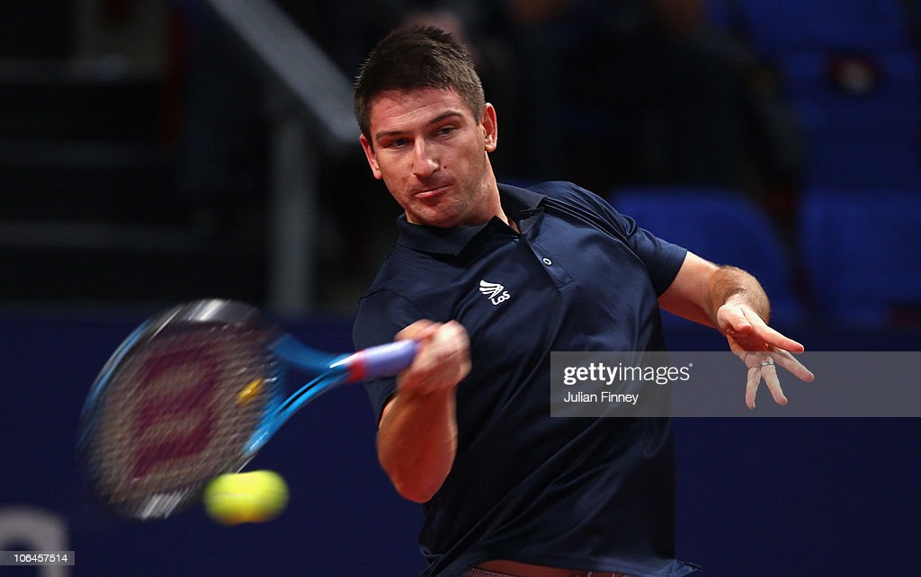 <a gi-track='captionPersonalityLinkClicked' href=/galleries/search?phrase=Jan+Hajek&family=editorial&specificpeople=553819 ng-click='$event.stopPropagation()'>Jan Hajek</a> of Czech Republic in action against David Nalbandian of Argentina during Day Two of the Davidoff Swiss Indoors Tennis at St Jakobshalle on November 2, 2010 in Basel, Switzerland.