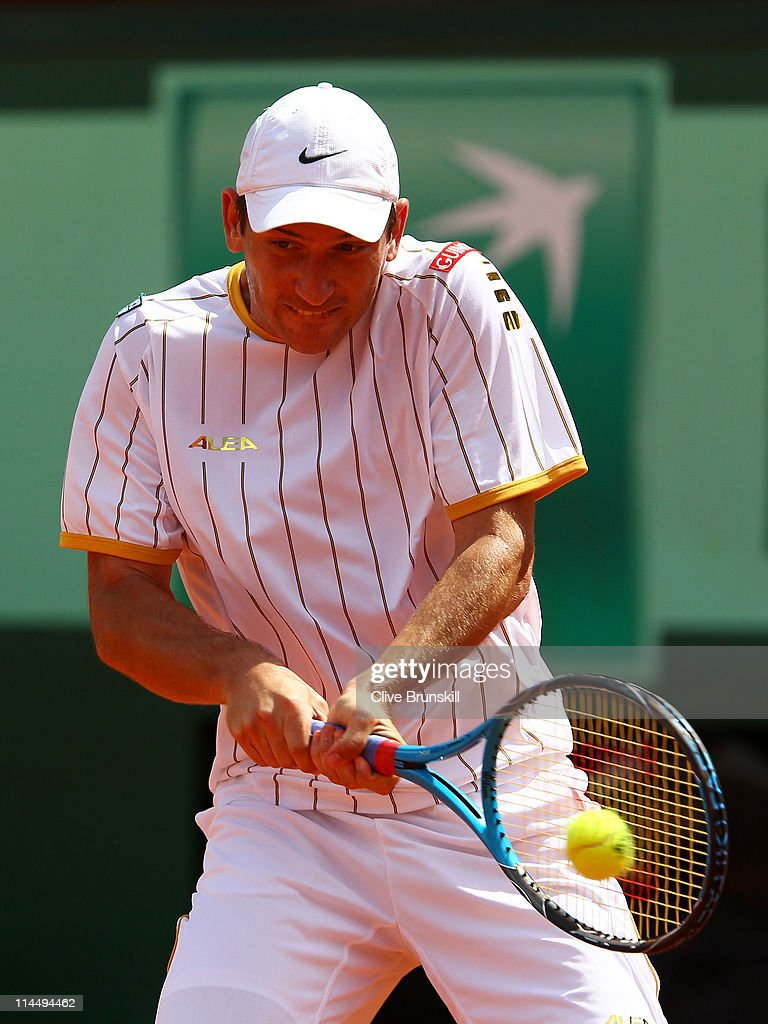 <a gi-track='captionPersonalityLinkClicked' href=/galleries/search?phrase=Jan+Hajek&family=editorial&specificpeople=553819 ng-click='$event.stopPropagation()'>Jan Hajek</a> of Czech Republic plays a backhand during the men's singles round one match between <a gi-track='captionPersonalityLinkClicked' href=/galleries/search?phrase=Jan+Hajek&family=editorial&specificpeople=553819 ng-click='$event.stopPropagation()'>Jan Hajek</a> of Czech Republic and Jo-Wilfried Tsonga of France on day one of the French Open at Roland Garros on May 22, 2011 in Paris, France.