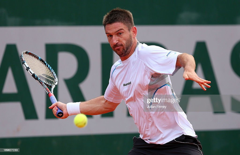 <a gi-track='captionPersonalityLinkClicked' href=/galleries/search?phrase=Jan+Hajek&family=editorial&specificpeople=553819 ng-click='$event.stopPropagation()'>Jan Hajek</a> of Czech Republic plays a forehand in his Men's Singles match against Sam Querry of United States of America during day four of the French Open at Roland Garros on May 29, 2013 in Paris, France.
