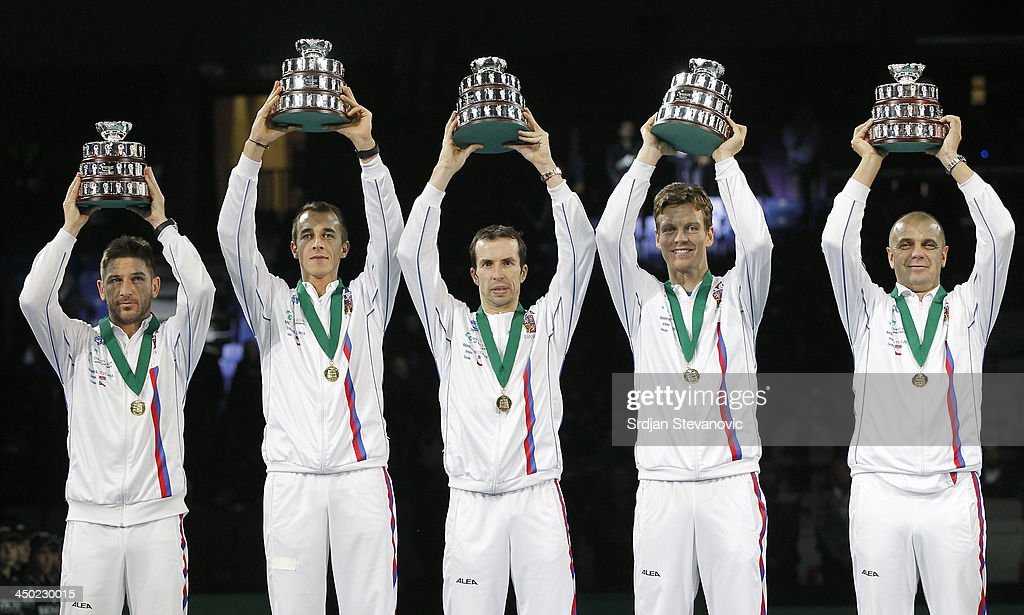 Jan Hayek, Lukas Rosol, Radek Stepanek, Tomas Berdych and team captain Vladimir Safarik of Czech Republic hold the winners trophy aloft after a 3-2 victory against Serbia during the award ceremony of the Davis Cup World Group Final between Serbia and Czech Republic at Kombank Arena on November 17, 2013 in Belgrade, Serbia.