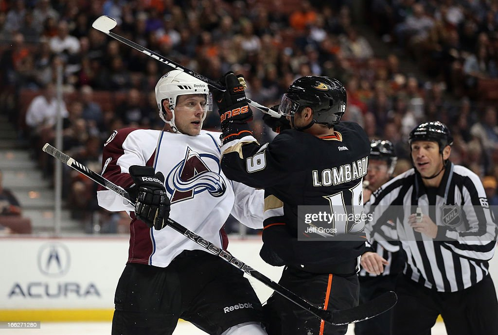 Jan Hejda (L) #8 of the Colorado Avalanche and Matthew Lombardi #19 of the Anaheim Ducks tussle in the third period at Honda Center on April 10, 2013 in Anaheim, California. The Avalanche defeated the Ducks 4-1.
