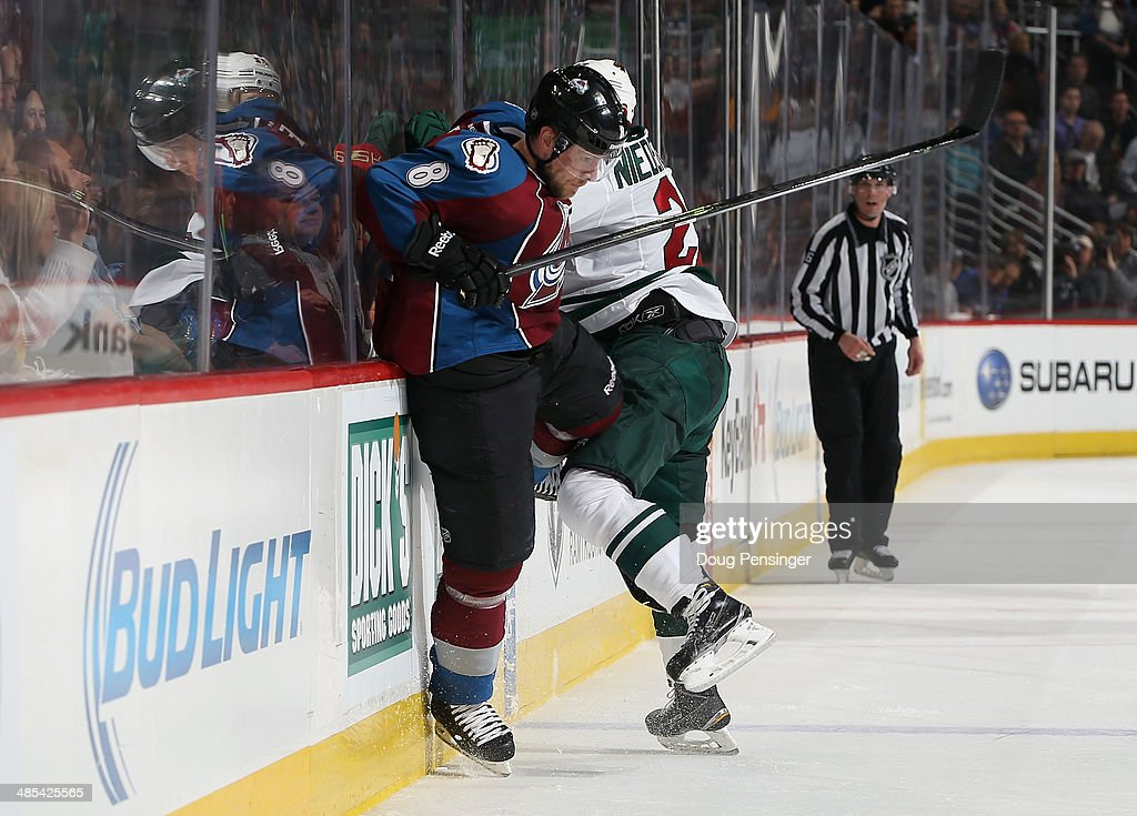 <a gi-track='captionPersonalityLinkClicked' href=/galleries/search?phrase=Jan+Hejda&family=editorial&specificpeople=624333 ng-click='$event.stopPropagation()'>Jan Hejda</a> #8 of the Colorado Avalanche avoids an attempted hit by <a gi-track='captionPersonalityLinkClicked' href=/galleries/search?phrase=Nino+Niederreiter&family=editorial&specificpeople=6667732 ng-click='$event.stopPropagation()'>Nino Niederreiter</a> #22 of the Minnesota Wild in Game One of the First Round of the 2014 NHL Stanley Cup Playoffs at Pepsi Center on April 17, 2014 in Denver, Colorado. The Avalanche defeated the Wild 5-4 in overtime to take a 1-0 game advantage in the series.