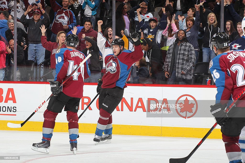 <a gi-track='captionPersonalityLinkClicked' href=/galleries/search?phrase=Jan+Hejda&family=editorial&specificpeople=624333 ng-click='$event.stopPropagation()'>Jan Hejda</a> #8 of the Colorado Avalanche celebrates a goal against the Winnipeg Jets at the Pepsi Center on October 27, 2013 in Denver, Colorado. The Avalanche defeated the Jets 3-2.