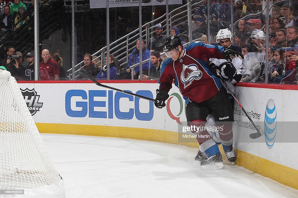 <a gi-track='captionPersonalityLinkClicked' href=/galleries/search?phrase=Jan+Hejda&family=editorial&specificpeople=624333 ng-click='$event.stopPropagation()'>Jan Hejda</a> #8 of the Colorado Avalanche checks <a gi-track='captionPersonalityLinkClicked' href=/galleries/search?phrase=Evander+Kane&family=editorial&specificpeople=4303789 ng-click='$event.stopPropagation()'>Evander Kane</a> #9 of the Winnipeg Jets at the Pepsi Center on October 27, 2013 in Denver, Colorado.