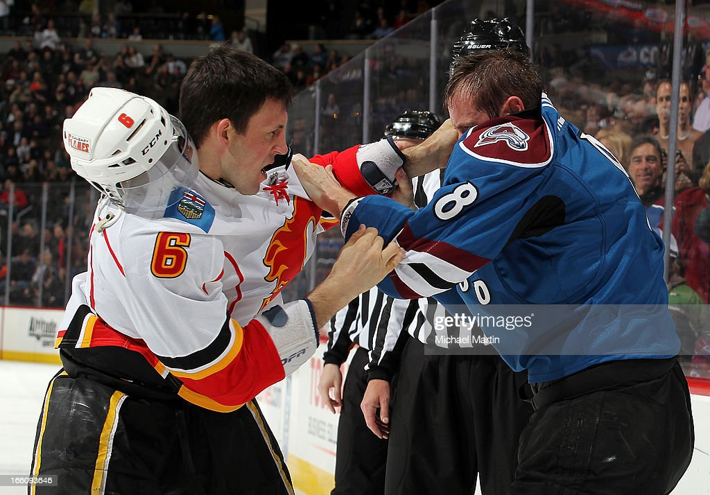 <a gi-track='captionPersonalityLinkClicked' href=/galleries/search?phrase=Jan+Hejda&family=editorial&specificpeople=624333 ng-click='$event.stopPropagation()'>Jan Hejda</a> #8 of the Colorado Avalanche fights with <a gi-track='captionPersonalityLinkClicked' href=/galleries/search?phrase=Cory+Sarich&family=editorial&specificpeople=204153 ng-click='$event.stopPropagation()'>Cory Sarich</a> #6 of the Calgary Flames at the Pepsi Center on April 8, 2013 in Denver, Colorado.