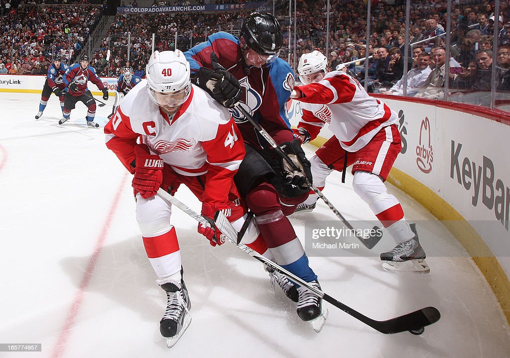 <a gi-track='captionPersonalityLinkClicked' href=/galleries/search?phrase=Jan+Hejda&family=editorial&specificpeople=624333 ng-click='$event.stopPropagation()'>Jan Hejda</a> #8 of the Colorado Avalanche skates the puck against <a gi-track='captionPersonalityLinkClicked' href=/galleries/search?phrase=Henrik+Zetterberg&family=editorial&specificpeople=201520 ng-click='$event.stopPropagation()'>Henrik Zetterberg</a> #40 and <a gi-track='captionPersonalityLinkClicked' href=/galleries/search?phrase=Justin+Abdelkader&family=editorial&specificpeople=2271858 ng-click='$event.stopPropagation()'>Justin Abdelkader</a> #8 of the Detroit Red Wings at the Pepsi Center on April 5, 2013 in Denver, Colorado.