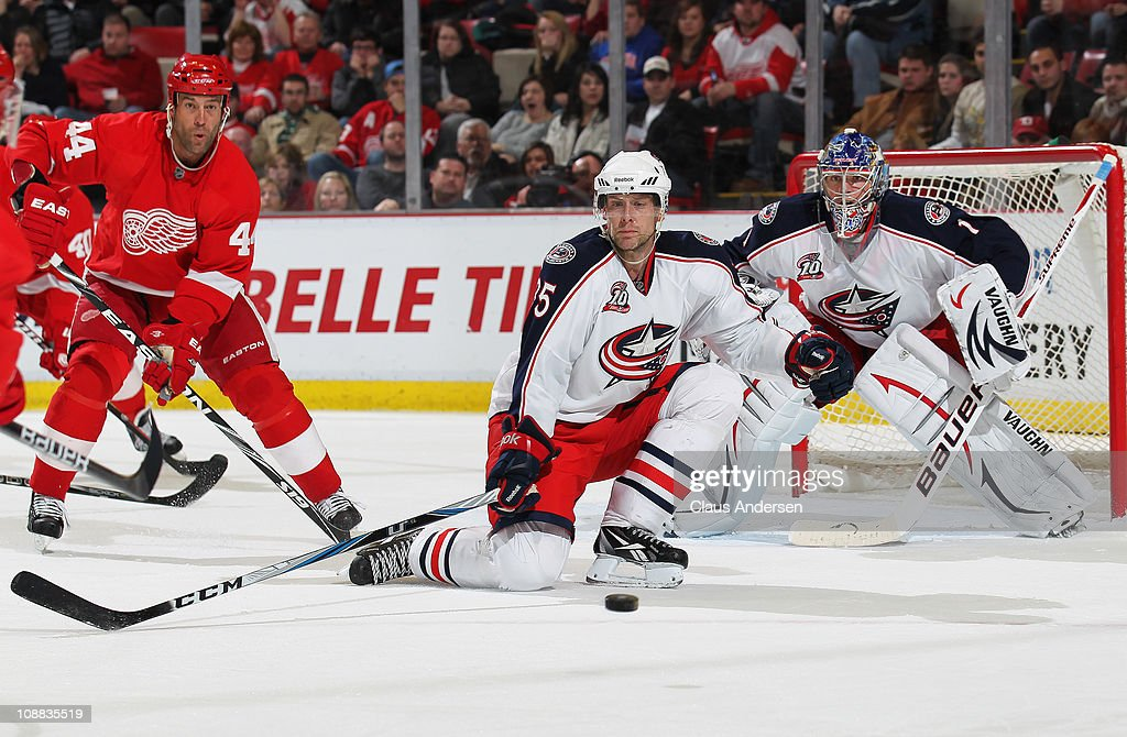 <a gi-track='captionPersonalityLinkClicked' href=/galleries/search?phrase=Jan+Hejda&family=editorial&specificpeople=624333 ng-click='$event.stopPropagation()'>Jan Hejda</a> #35 of the Columbus Blue Jackets tries to stop a puck from getting to <a gi-track='captionPersonalityLinkClicked' href=/galleries/search?phrase=Todd+Bertuzzi&family=editorial&specificpeople=202476 ng-click='$event.stopPropagation()'>Todd Bertuzzi</a> #44 of the Detroit Red Wings in a game on February 4, 2011 at the Joe Louis Arena in Detroit, Michigan. The Blue Jackets defeated the Wings 3-0.
