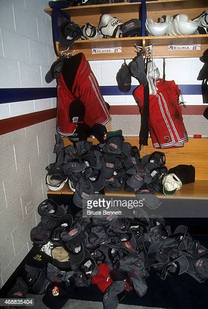 Jan Hlavac of the New York Rangers has his locker stall filled with hats after he scored his first career hat trick against the Boston Bruins on...