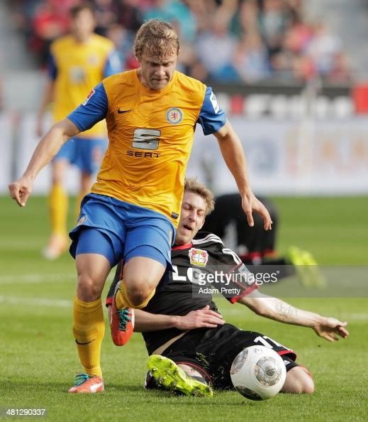 Jan Hochscheidt of Braunschweig is challenged by Stefan Kiessling of Leverkusen during the Bundesliga match between Bayer Leverkusen and Eintracht...