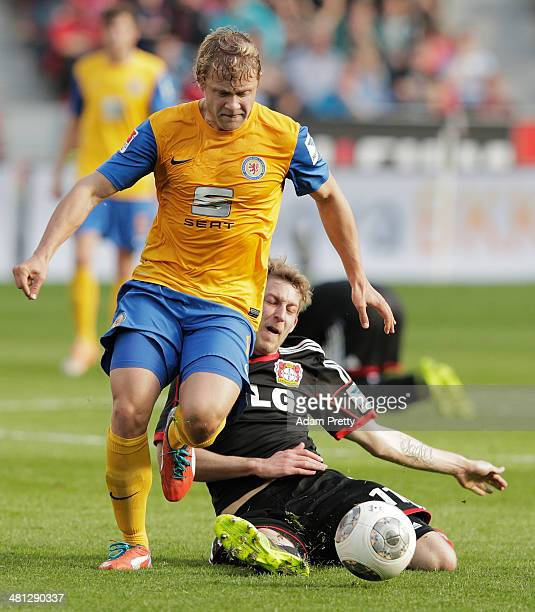 Jan Hochscheidt of Braunschweig is challenged by Stefan Kiessling of Leverkusen during the Bundesliga match between Bayer Leverkusen and Eintracht...