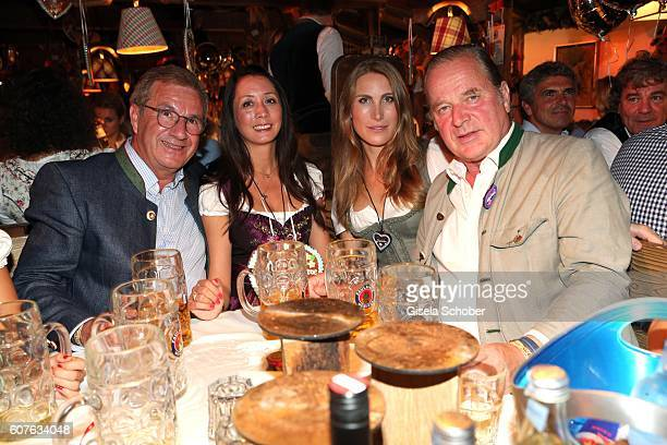 Jan Hofer and his partner Phong Lan Truong Enno von Ruffin and his girlfriend Estelle Rytterborg during the 'Almauftrieb' as part of the Oktoberfest...