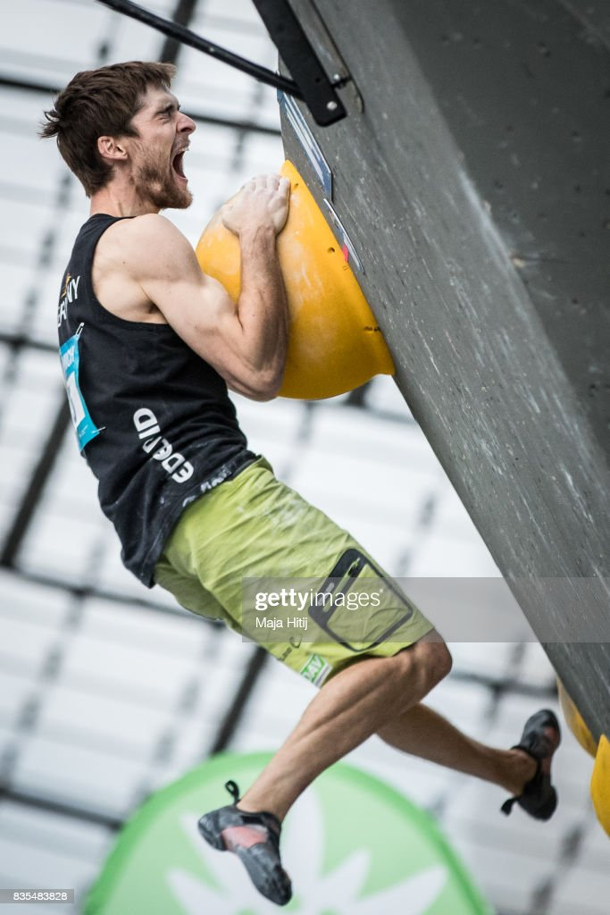 Jan Hojer of Germany celebrates as he reaches the top during semi finals of the IFSC Climbing World Cup Munich on August 19, 2017 in Munich, Germany.
