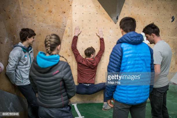 Jan Hojer of Germany stretches prior bouldering event Studio Bloc Masters 2017 on March 26 2017 in Pfungstadt Germany