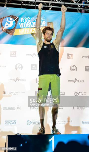 Jan Hoyer of Germany celebrates afetr winning the men's event of the IFSC Bouldering Worldcup in the southern German city of Munich on August 19 2017...