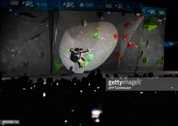 Jan Hoyer of Germany competes in the men's event of the IFSC Bouldering Worldcup in the southern German city of Munich on August 19 2017 / AFP PHOTO...