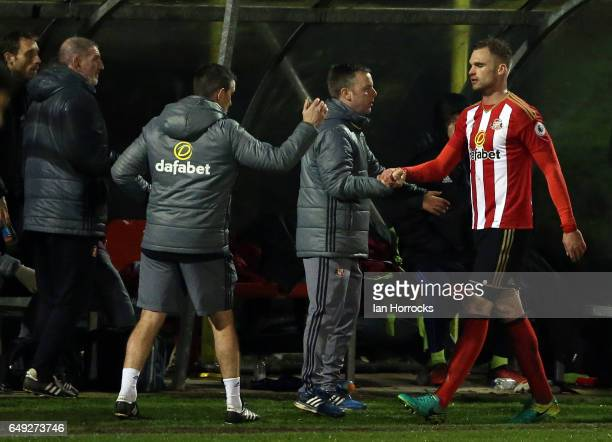 Jan Kirchhoff of Sunderland shakes with coach Elliot Dickman after he makes his comeback from injury during the Premier League 2 match between...