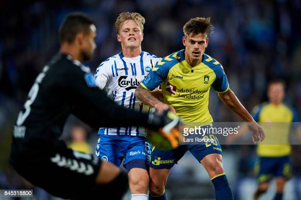 Jan Kliment of Brondby IF and Jeppe Tverskov of OB Odense compete for the ball during the Danish Alka Superliga match between OB Odense and Brondby...