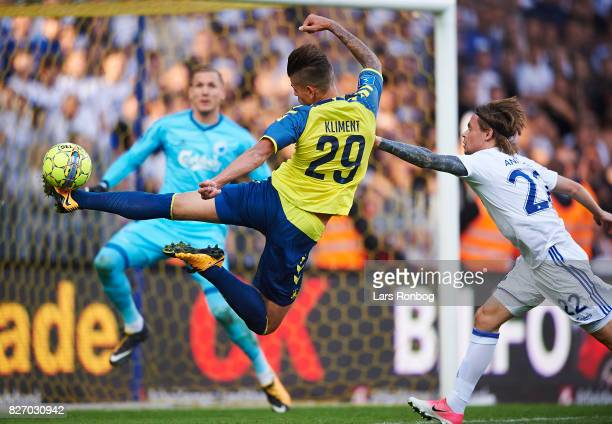 Jan Kliment of Brondby IF in action in front of Goalkeeper Robin Olsen of FC Copenhagen during the Danish Alka Superliga match between Brondby IF and...