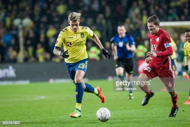 Jan Kliment of Brondby IF in front of Mathias Tauber of Lyngby BK the Danish Alka Superliga match between Brondby IF and Lyngby BK at Brondby Stadion...
