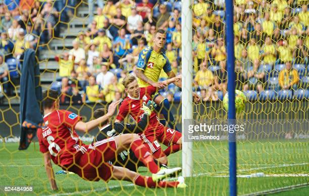 Jan Kliment of Brondby IF scores the 11 goal against Goalkeeper Andreas Larsen of Lyngby BK during the Danish Alka Superliga match between Brondby IF...