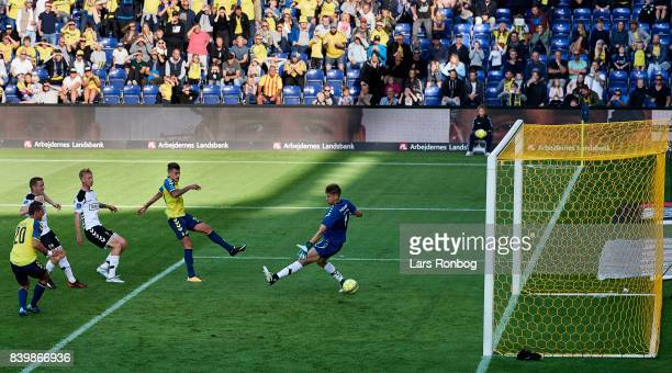 Jan Kliment of Brondby IF scores the 20 goal against Goalkeeper Jesse Joronen of AC Horsens during the Danish Alka Superliga match between Brondby IF...