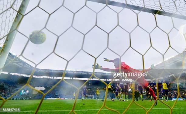 Jan Kliment of Brondby IF scores there 20 goal against Goalkeeper Jesper Hansen of FC Midtjylland during the Danish Alka Superliga match between...