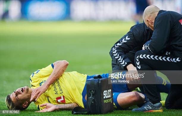 Jan Kliment of Brondby IF under treatment from Peter Schmidt physio of Brondby IF and Jonas Vestergard Iversen team doctor of Brondby IF during the...