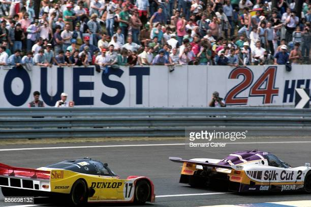 Jan Lammers HansJoachim Stuck Jaguar XJR9LM488 Porsche 962C 24 Hours of Le Mans Le Mans 12 June 1988 HansJoachim Stuck chasing Jan Lammers the two...