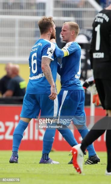 Jan Loehmannsroeben in discussion with Rene Eckardt of Jena during the 3Liga match between FC Carl Zeiss Jena and SC Fortuna Köln at...