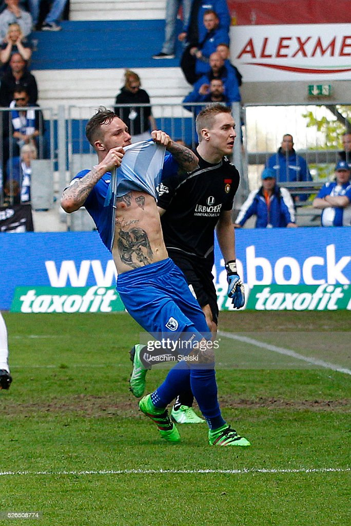 Jan Loehmannsroeben of Magdeburg challenges Christopher Gaeng of Sonnenhof-Grossaspach during the Third League match between 1. FC Magdeburg and SG Sonnenhof-Grosssaspach at MDCC-Arena on April 30, 2016 in Magdeburg, Germany.