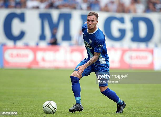 Jan Loehmannsroeben of Magdeburg runs with the ball during the Third League match between 1 FC Magdeburg and Hallescher FC at MDCCArena on August 16...