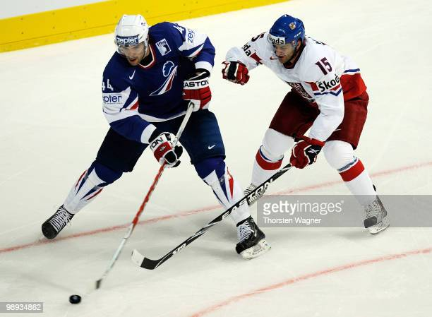 Jan Marek of Czech Republic battles for the puck with Antonin Manavian of France during the IIHF World Championship group C match between Czech...