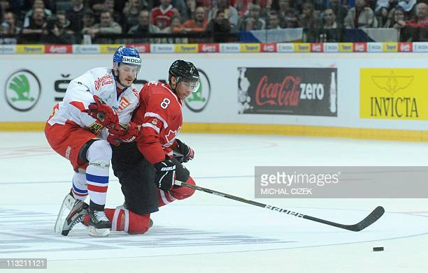 Jan Marek of Czech Republic fights for a puck with Evander Kane of Canada during their friendly match Czech Rep vs Canada on April 27 2011 in Prague...