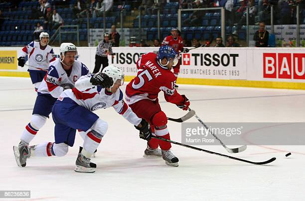 Jan Marek of Czech Republic fights for the puck with Tommy Jakobsen and Jonas Holos of Norway during the IIHF World Ice Hockey Championship...