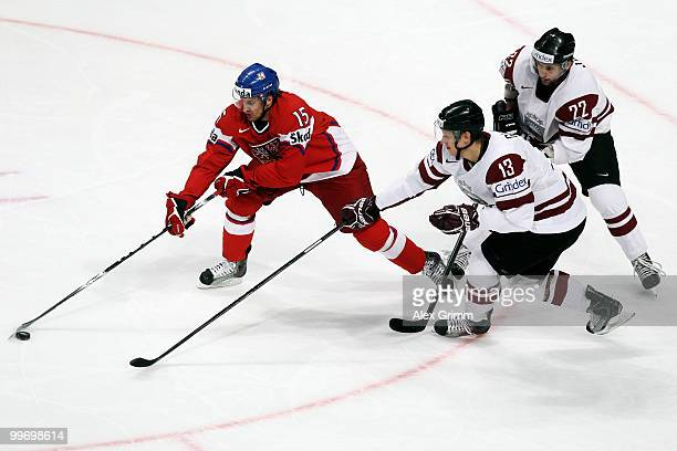Jan Marek of Czech Republic is challenged by Guntis Galvins and Maris Jass of Latvia during the IIHF World Championship group F qualification round...