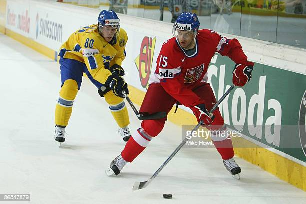 Jan Marek of Czech Republic is hooked by Mattias Weinhandl of Sweden during the IIHF World Championship QuarterFinal between Sweden and Czech...