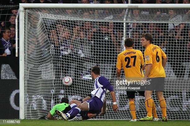 Jan Mauersberger of Osnabrueck scores the first goal against Benjamin Kirsten of Dresden during the Second Bundesliga playoff second leg match...