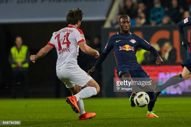 Jan Moravek of Augsburg and Naby Keita of Leipzig battle for the ball during the Bundesliga match between FC Augsburg and RB Leipzig at WWK Arena on...