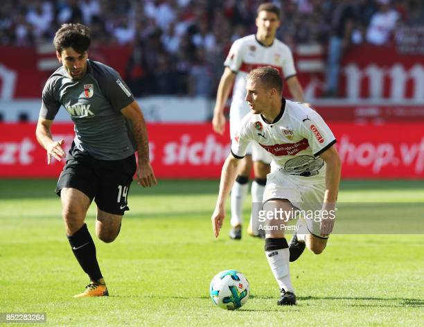 Jan Moravek of Augsburg challenges Santiago Ascacibar of VfB Stuttgart during the Bundesliga match between VfB Stuttgart and FC Augsburg at...