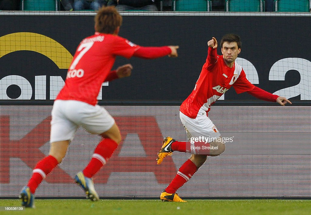 Jan Movarek (R) of Augsburg celebrates his team's first goal during the Bundesliga match between VFL Wolfsburg and FC Augsburg at Volkswagen Arena on February 2, 2013 in Wolfsburg, Germany.
