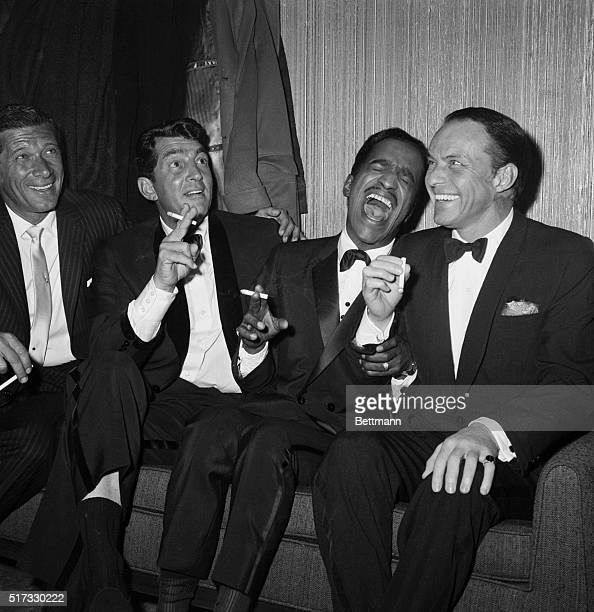 Jan Murray sits alongside Rat Pack members Dean Martin Sammy Davis Jr and Frank Sinatra as the group unwinds backstage at Carnegie Hall after...