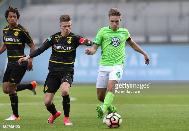 Jan Neuwirt of Wolfsburg vies with Dzenis Burnic and Etienne Amenyido of Dortmund during the AJuniors German Championship semi final first leg match...