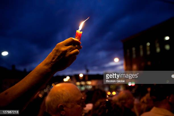 Jan Nichols holds a candle high for Tony Woo Nichols who knew Tony for eight or nine years said she was at the vigil for Tony but also to support the...